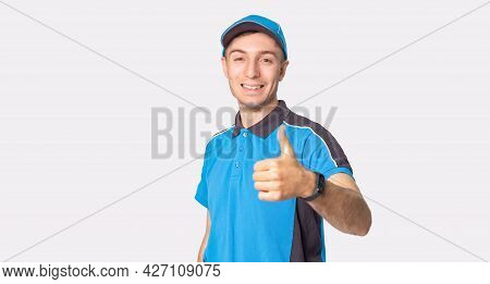 The Courier Man In Work Uniform Holding His Thumb Up Means He Is Happy For Working As A Delivery Man