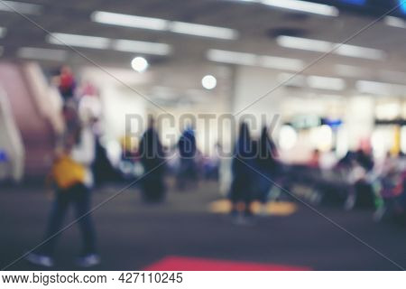 Abstract Blur Background Of People Or Passenger Walking In Or Hurry Up In Airport Transport Terminal