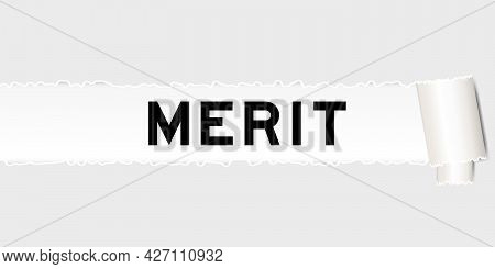 Ripped Gray Paper That Have Word Merit Under Torned Part