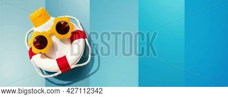 Sunblock Bottle Wearing Sunglasses And A Buoy - Flat Lay