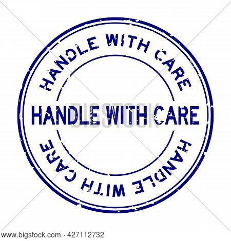 Grunge Blue Handle With Care Word Round Rubber Seal Stamp On White Background