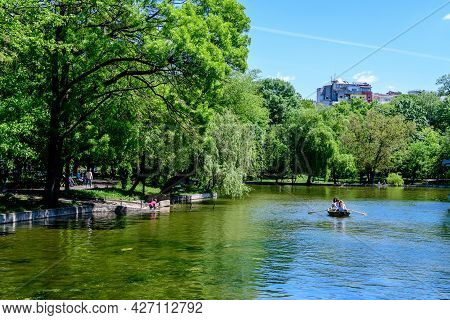 Bucharest, Romania - 9 May 2021: Vivid Green Landscape With Old Large Linden Trees And Green Leaves