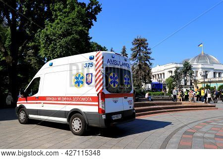 An Ambulance Car Is On Duty At Rally Near Ukrainian Parliament, Verkhovna Rada. Ambulance Is Providi