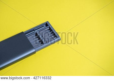 A Set Of Screwdrivers With Bits In A Case On A Yellow Background. Copyspace, Tools For Work