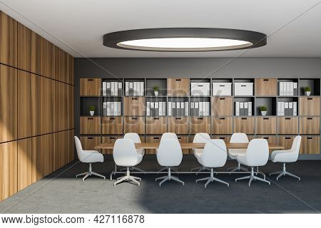 Modern Meeting Room With Wide Round Light, Long Shelving Unit Tied With Original Wall With Wooden Al