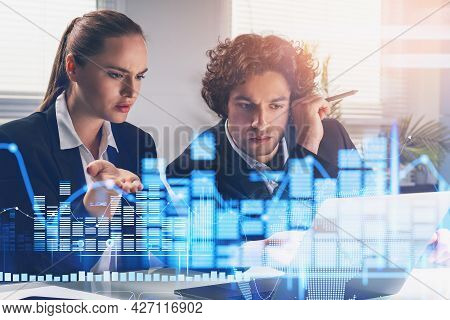 Business Woman Trader And Businessman In Formal Suits Is Working Together With Financial Report. For