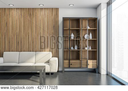 Interior With Modern Cupboard And Light Beige Sofa With Coffee Table In The White Living Room With W