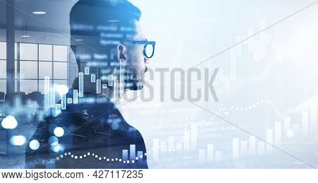 Over The Shoulder Shot Of Businessman In Glasses And Suit Looking At Financial Graphs, Candlestick,