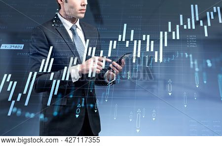 Ambitious Businessman In Formal Suit Is Holding The Smart Phone And Touching The Screen. Concept Of