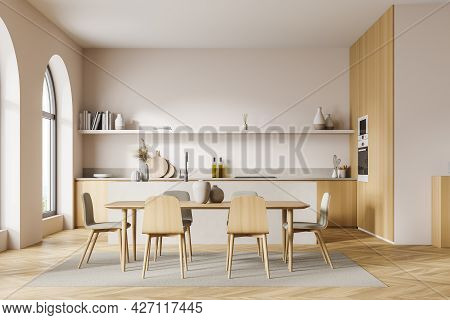 Studio Kitchen With Arch Window, Pinky White Walls And Wooden Details. Parquet Floor With Carpet. In