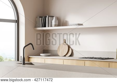 Corner View Of Kitchen Interior With Stone And Wooden Details, Pinky Walls, Arch Window And Double S