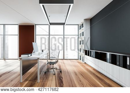 Workplace In The Panoramic Office Interior With Dark Grey Niche Inside The Shelving Unit And Mild Sh