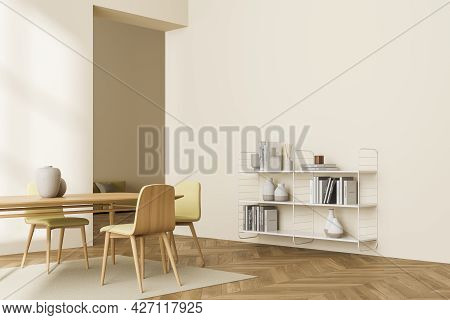 Interior Of Light Yellow Living Room With White Bookshelf On One Wall And Table With Three Chairs At