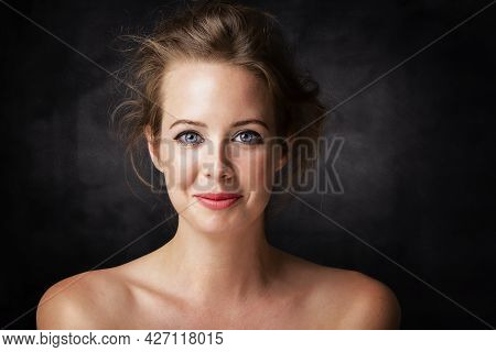 Close-up Beauty Portrait Of Gorgeous Woman Wearing Perfect Makeup While Standing At Isolated Dark Ba