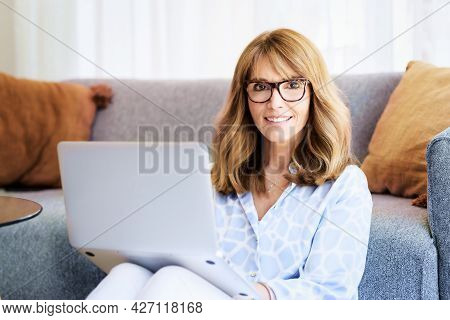 Attractive Mature Woman Working Laptop At Home