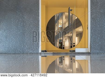 Elements Of Architectural Decorations Of Buildings, Glass Doorways And Yellow Circular Arches Entran