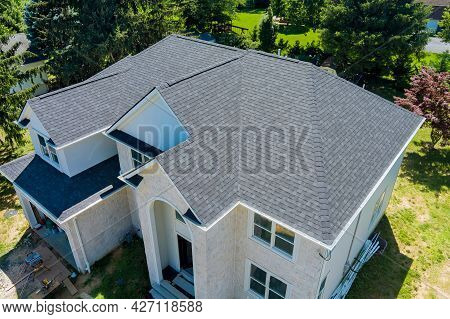 Aerial View Of Asphalt Shingles Construction Site Roofing The House With New Window