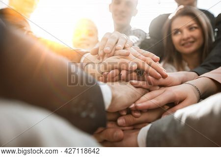 Close Up. A Group Of Young Business People Showing Their Unity
