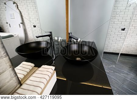 Luxurious Washbasin On A Black Marble Countertop In A Wellness Spa Clinic With Modern Equipment.