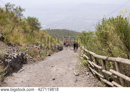 Mount Vesuvius, Italy - July 29, 2021: Tourists Walking Along The Footpath To The Top Of Vesuvius Vo