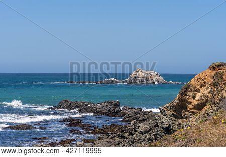 San Simeon, Ca, Usa - June 8, 2021: Pacific Ocean Coastline North Of Town. Closeup Of Piedras Blanca