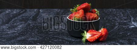 Strawberries On Black Marble. Ripe Strawberries In A Saucer On A Black Background. Place To Insert T