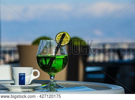 Naples, Italy - January 21, 2017: A Glass With Green Liqueur And Cup Of  Coffee Served In The Small