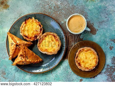 Mini Quiches On A Blue Plate With Cup Of Coffee Espresso. Flaky Dough Pies. Samosa, Samsa Meat Stuff