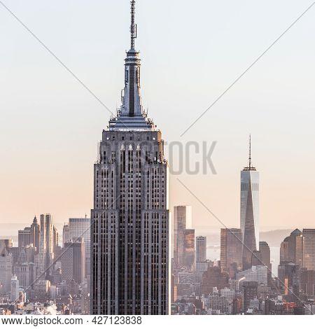New York City Manhattan Downtown Skyline At Sunset.