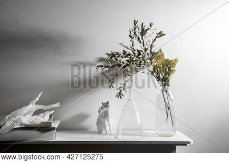 A Vase With Dry Eucalyptus, Pieces Of Paper, A Figurine With A Fox. Scandinavian Style.