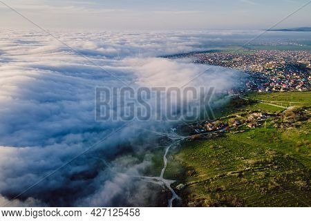 Aerial View With Creeping Clouds And Mountains. Foggy Weather