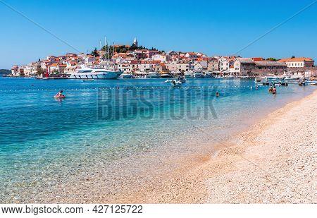 Primosten, Sibenik Knin County, Croatia. View Of The Old Town And Beach In Primosten Town, Dalmatia,