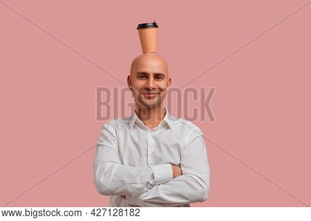 This Is Real Energy. Funny Bald Man With Bristle, Holds Paper Cup On Head, Looks Peppy, Happy, Cheer