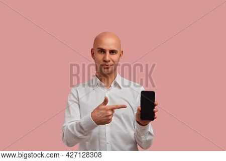 Advertising Of Your Product. Confident Bald Man With Bristle Shows Application On Screen Smartphone,