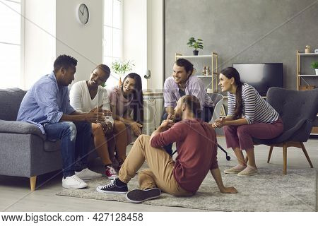Various Friends Of Girls And Boys Who Sit At Home And Communicate Enjoy Spending Time Together.
