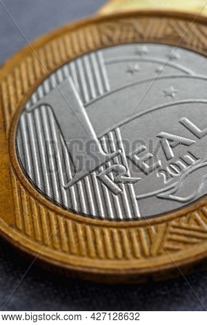 Brazilian 1 One Real Coin Close-up. Money In Brazil. Vertical Illustration About Economy, Finance An
