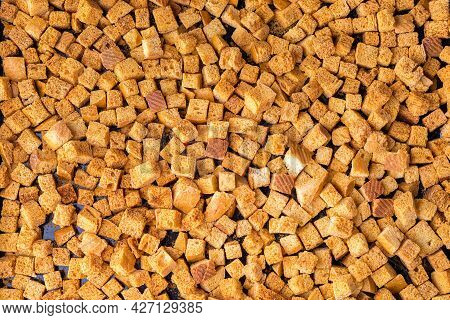 Square-shaped Bread Crumbs. Oven-fried Golden Brown Bread Crumbs. Background.