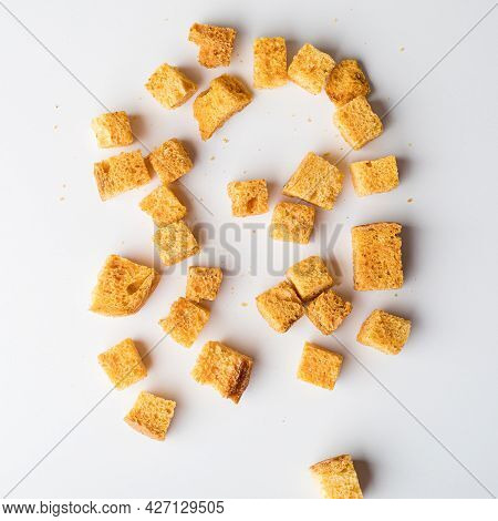 Square Breadcrumbs. Oven-fried Golden Brown Bread Crumbs. White Background