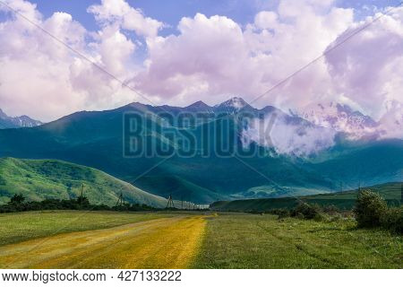 Country Road Towards Mountains With Clouds, Republic Of Ingushetia, Fiagdon, City Of The Dead, Road