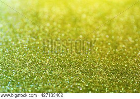 Shiny Green Glitter As Background. Bokeh Effect
