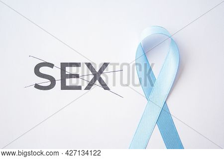 Blue Ribbon As Prostate Cancer Symbol On White Paper With Strikethrough Quote Sex, Quality Of Life W