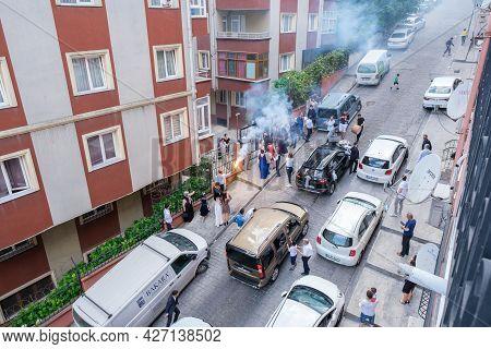 Beyoglu, Istanbul, Turkey - 07.04.2021: Turkish People Gathering Around The House Of Bride And Groom
