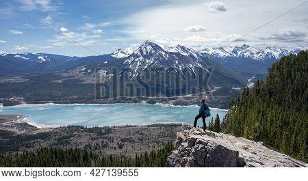 Hiker Enjoying Beautiful Alpine Vista In Canadian Rockies At Prairie View Trail, Kananaskis, Alberta