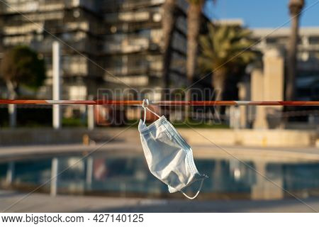 Hotel In Cyprus And Security Tape Outside. Bankruptcy Of Hotel Tourist Businesses During Quarantine