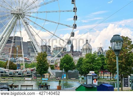 Canada, Montreal - July 11, 2021: Scenic View Of Old Port Of Montreal. Ferris Wheel La Grande Roue,