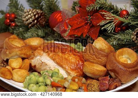On A Serving Plate A Christmas Roast Turkey Dinner With All The Trimmings Of Brussel Sprouts, Roast