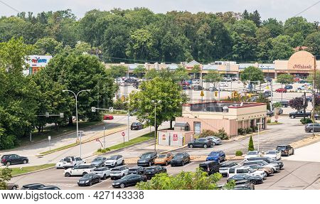 Monroeville, Pennsylvania, Usa July 18, 2021 Holiday Center Shopping Mall In The Background With The