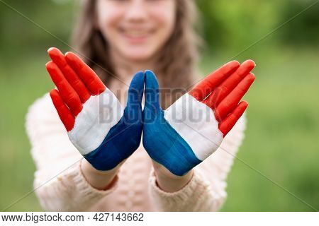 Croatia Flag Painted On Child Hands. Girl With Open Hands Raised, Focus On Hands. Patriotic Holiday.
