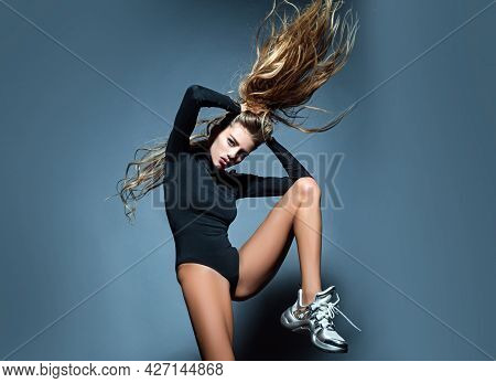 Fashion Move And Posing. Gorgeous Seductive Model Girl Moving Her Long Hair.