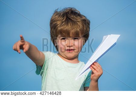 Happy Child. Cute Boy With Paper Aipplene. Happy Child With Paper Toy Airplane Looking At Camera. Ch